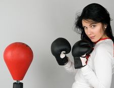 Free A Young Woman In Boxing Gloves Royalty Free Stock Image - 13582436