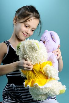 Free White Child Playing With Teddy Bear Royalty Free Stock Photo - 13582475