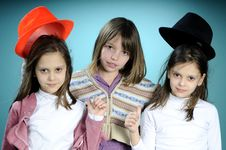 Three Girls With Colored Accessories Royalty Free Stock Photo