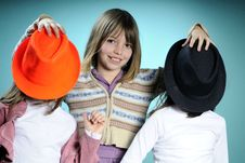 Three Girls With Colored Accessories Royalty Free Stock Images