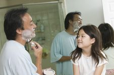 Father Shaving Beeing Watched By Daughter Stock Photography