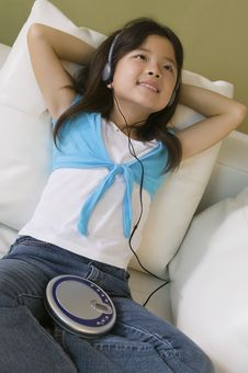 Girl Lying In Bed Listening To Music Stock Photos