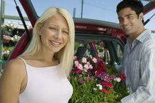 Couple Loading Plants Into Minivan Royalty Free Stock Photo