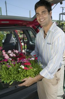 Free Man Loading Flowers Into Back Of Van Royalty Free Stock Image - 13583956