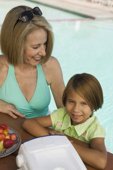 Girl With Grandmother At Pool Stock Image