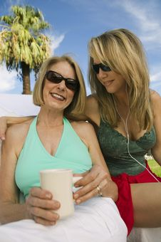 Free Two Women Sitting On Sunlounger Stock Image - 13583991