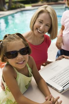 Two Girls Using Laptop With Grandmother Stock Photos