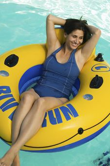 Free Woman Lying On Inflatable Raft Stock Image - 13584021