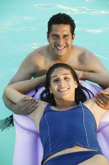 Free Couple In Swimming Pool Stock Photography - 13584022
