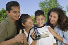 Free Boy Looking At Camcorder Royalty Free Stock Photography - 13584047
