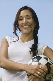 Free Woman Holding Soccer Ball Royalty Free Stock Photography - 13584067