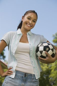 Free Woman Holding Soccer Ball. Royalty Free Stock Photos - 13584068