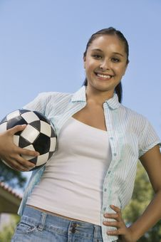 Free Young Woman Holding Soccer Ball Stock Images - 13584074