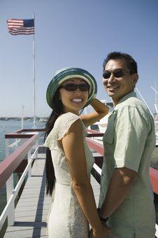 Couple On Pier Royalty Free Stock Photo