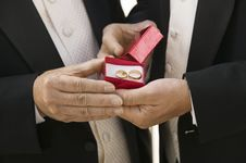 Groom And Father Holding Wedding Rings Stock Image
