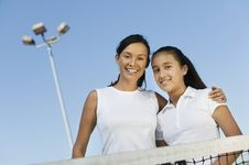 Free Mother And Daughter On Tennis Court Stock Photos - 13584263