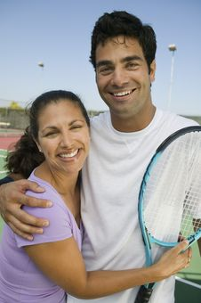 Mixed Doubles Tennis Players On Tennis Court Stock Image