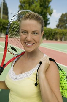 Free Woman With Tennis Racket And Tennis Balls Royalty Free Stock Images - 13584319