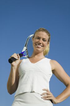 Female Tennis Player Holding Tennis Racket Stock Photo