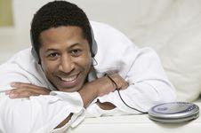 Man Lying On Sofa Listening To Music Royalty Free Stock Photos