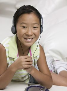 Free Young Girl Listening To Portable CD Player Royalty Free Stock Images - 13584369