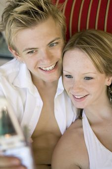 Young Couple Taking Camera Phone Picture Of Selves Stock Photos