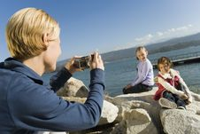 Free Mother Taking Picture Of Daughters At The Lake Stock Image - 13584481