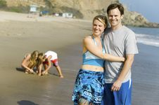 Free Couple With Family Enjoying Beach Stock Photos - 13584493