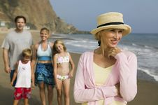 Free Grandmother At Beach With Family Stock Photography - 13584512