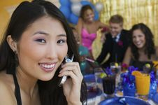 Teenager Girl Using Cell Phone At School Dance Royalty Free Stock Images