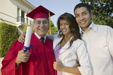 Free Senior Graduate With Son And Daughter Stock Image - 13584631