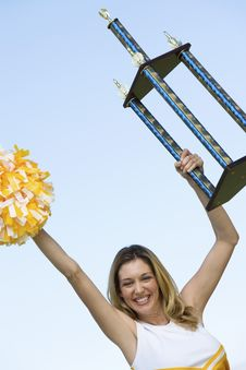 Free Smiling Cheerleader Holding Trophy Royalty Free Stock Photo - 13584665