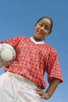 Free Girl (13-17) In Soccer Kit Holding Ball Stock Photography - 13584682