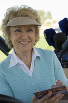 Free Senior Woman Holding Golf Score Card Stock Images - 13584724
