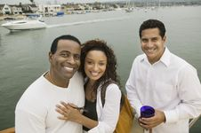 Couple With Friend On Yacht Stock Image
