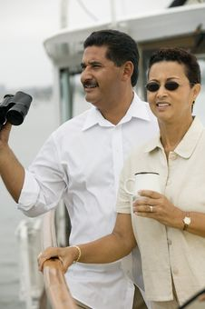 Couple On Yacht, Man Holding Binoculars Royalty Free Stock Images