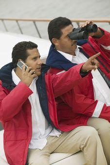 Free Two Men Relaxing On Yacht, Using Binoculars Stock Photography - 13584812