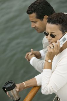 Couple Relaxing On Yacht, Woman Talking On Mobile Royalty Free Stock Photo