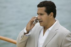 Man Talking On Mobile Phone On Boat Royalty Free Stock Photography