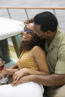 Free Couple Relaxing On Yacht Stock Image - 13584821