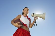 Free Cheerleader Holding Football And Megaphone Royalty Free Stock Photography - 13584927