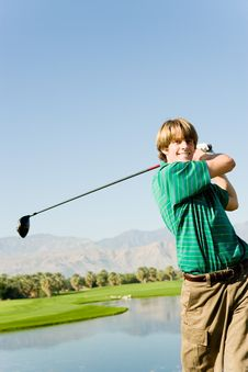 Free Golfer Swinging Club Stock Photo - 13584950