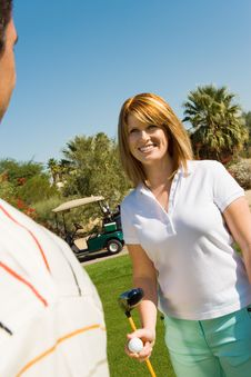 Free Couple Of Golfers Looking At Each Other Royalty Free Stock Images - 13584959