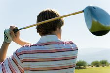 Free Golfer Swinging Club Stock Images - 13584974