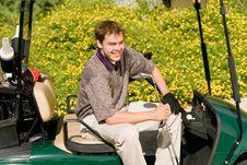 Free Golfer Sitting In Golf Cart Royalty Free Stock Photo - 13585005