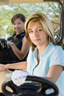 Free Two Female Golfers In Golf Cart Stock Photo - 13585010