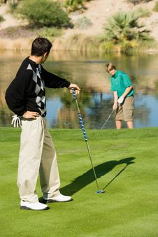 Golfer Watching Other Golfer Stock Photography