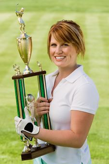 Free Female Golfer Holding Trophy Stock Photo - 13585020