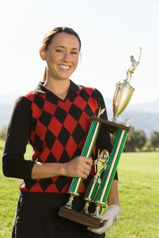 Free Female Golfer Holding Trophy Stock Photography - 13585022