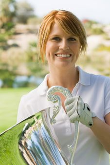 Free Female Golfer Holding Trophy Stock Images - 13585024